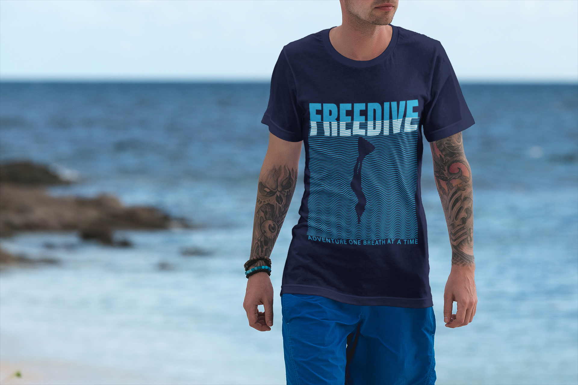 mockup-of-a-man-wearing-a-t-shirt-featuring-the-sea-in-the-background-3325-el1.png